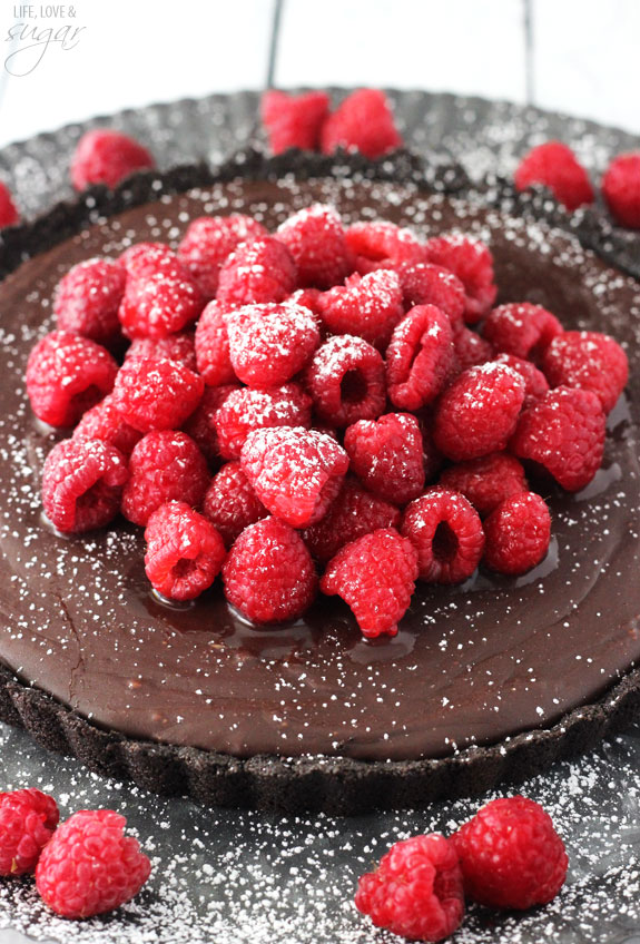 Nutella Raspberry Tart - smooth Nutella filling that is to die for, topped with sugar coated raspberries! No bake and to die for!