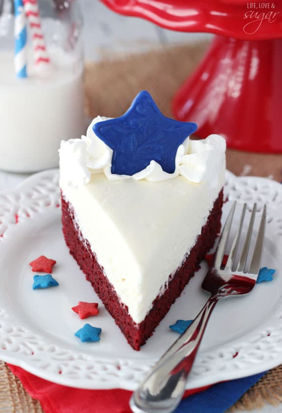 Red Velvet Blondie Cheesecake slice on a plate with a blue star on top