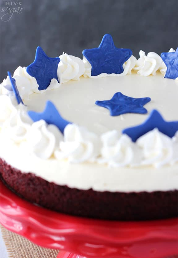 Red Velvet Blondie Cheesecake - a red velvet blondie toppwith with no bake cheesecake! With or without the stars, it's a delicious dessert! But the stars make it perfect for July 4th!