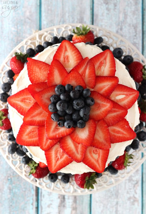 Fresh Berry Vanilla Layered Cake - layers of moist vanilla cake flavored with pureed strawberries and blueberries, layered with fresh berries and whipped cream!  #pictureperfectplate