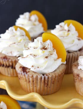 Close-up of Peach Cobbler Cupcakes on a yellow tray