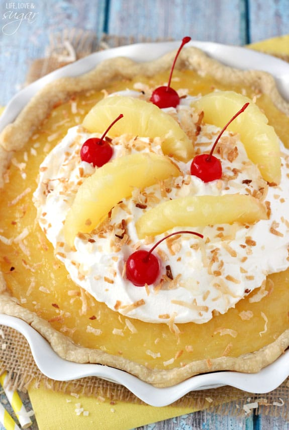 Pina Colada Pie - a light, mousse-like coconut filling with a pineapple topping and whipped cream! To die for!