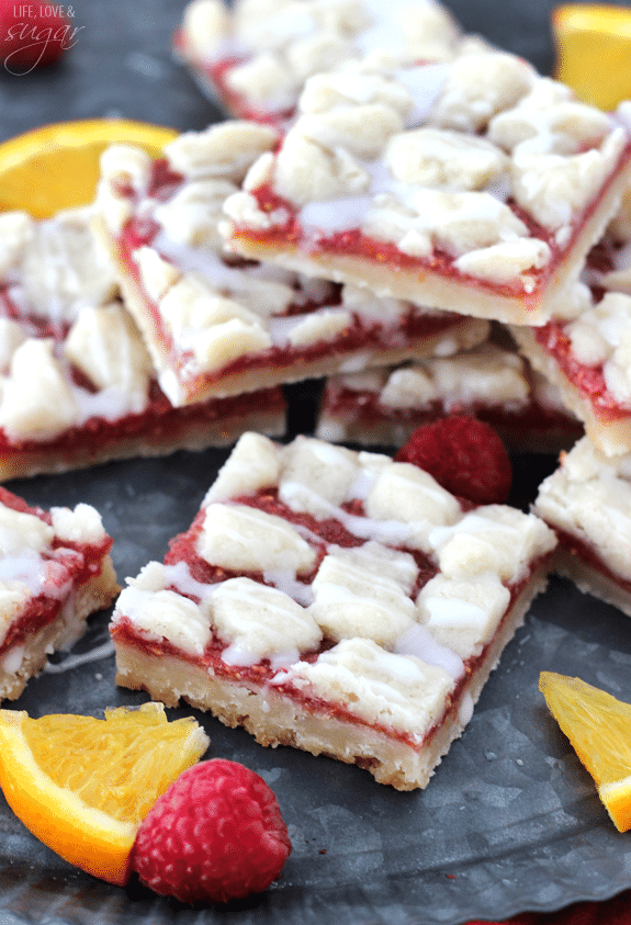 Raspberry Orange Shortbread Bars! Made with pulp left over from the juicer, giving you juice and bars from the same fruit!