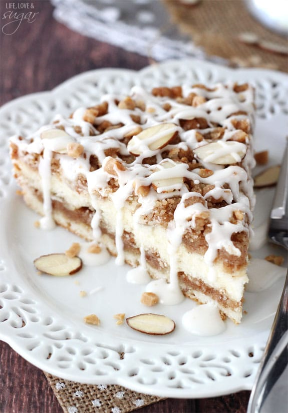 close up of Toffee Almond Streusel Coffee Cake slice on white doily plate