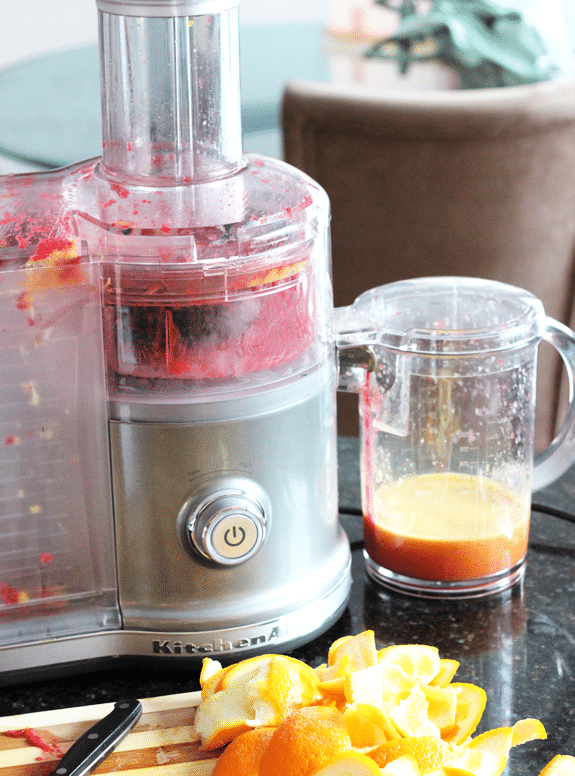 A juicer with ingredients for Raspberry Orange Shortbread Bars