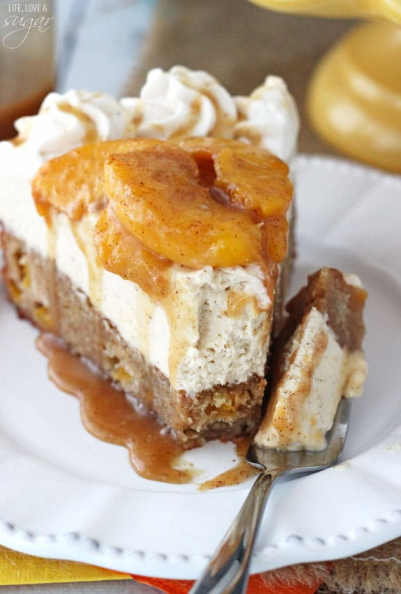 Peach Caramel Blondie Cheesecake - a cinnamon peach blondie, topped with caramel no bake cheesecake, cinnamon peaches, whipped cream and caramel! So good!