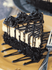 Peanut Butter Truffle Chocolate Cake slice on gold plate close up