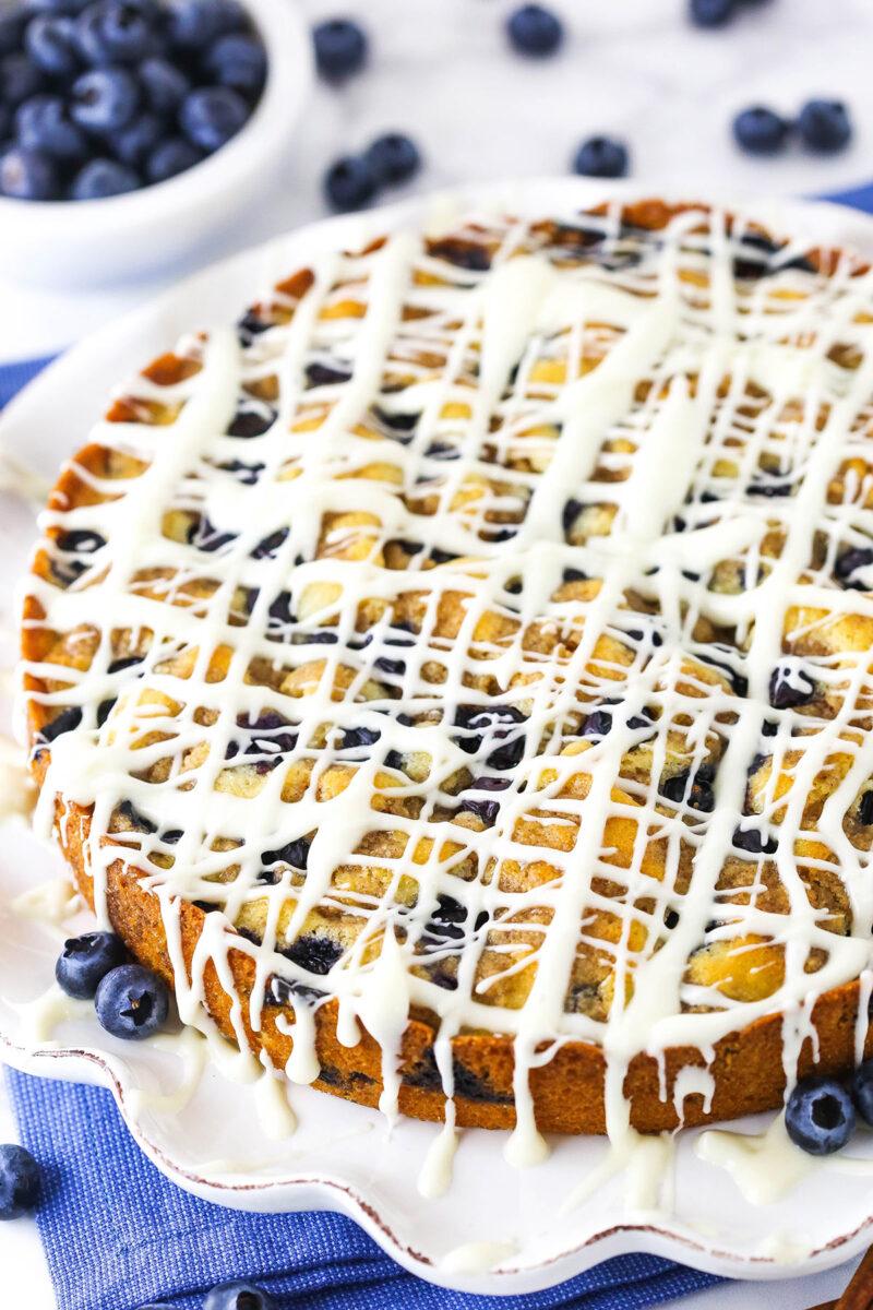 image of full blueberry streusel coffee cake on white platter