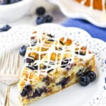 close up of slice of Blueberry Streusel Coffee Cake on white plate
