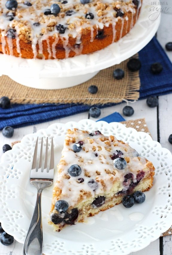 angled image of slice of Blueberry Streusel Coffee Cake and part of the cake
