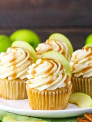 caramel apple cupcakes on a white plate with green napkin