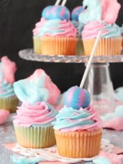 Cotton Candy Cupcakes with cotton candy on top and lollipop on top