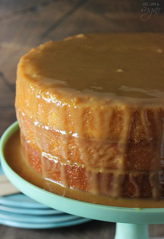 Moist cake drenched in caramel sauce on a cake stand