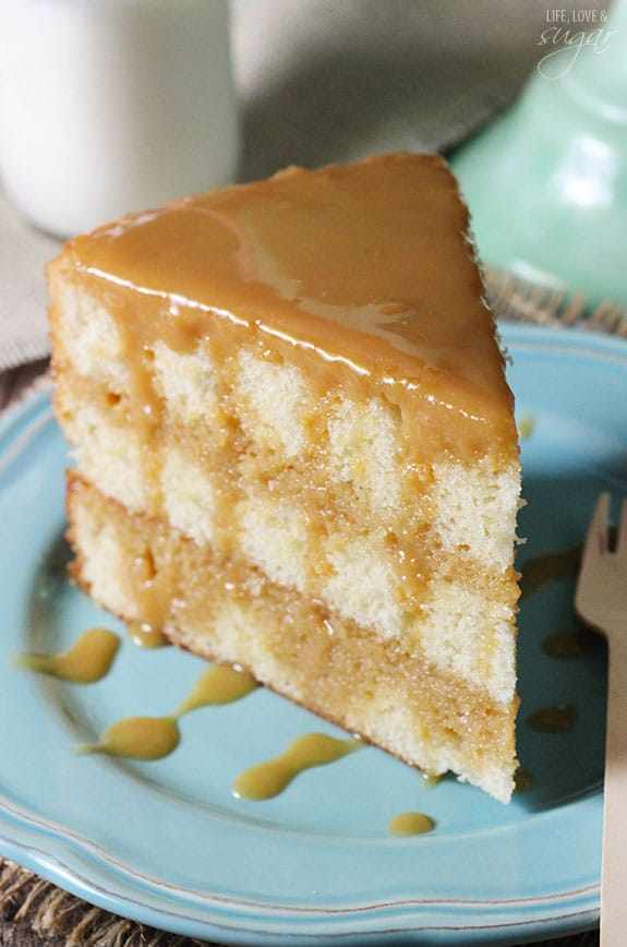 Fluffy slice of caramel cake on a blue plate.