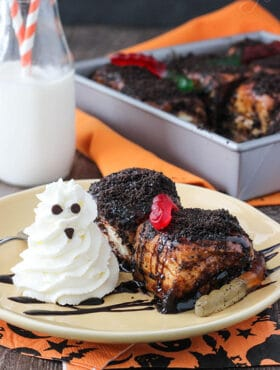 Two Chocolate Sticky Buns with gummy worms and a whipped cream ghost