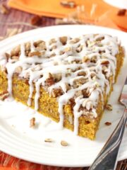 Cinnamon Streusel Pumpkin Coffee Cake slice on white plate close up
