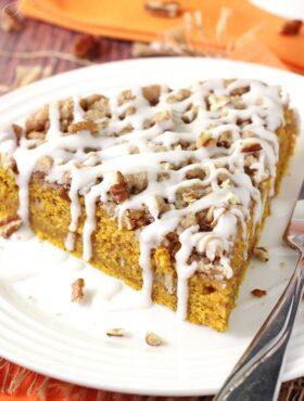 Cinnamon Streusel Pumpkin Coffee Cake slice on white plate close up