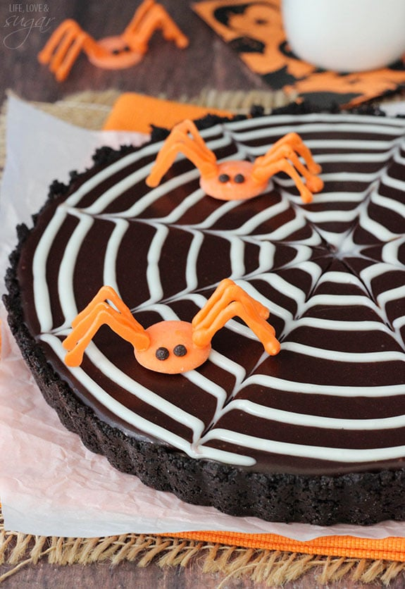 Spiderweb Chocolate Tart - a light chocolate tart with a chocolate ganache spiderweb and spiders made easily with candy melts!