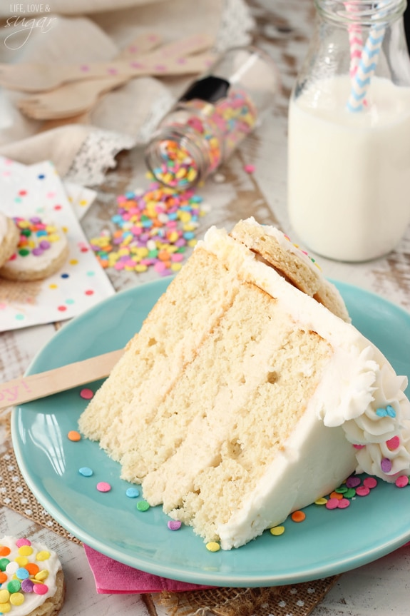 BAILEYS Frosted Vanilla Cookie Layer Cake slice on a blue plate