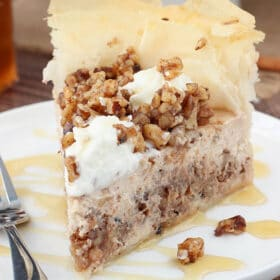 Baklava Cheesecake slice on white plate close up