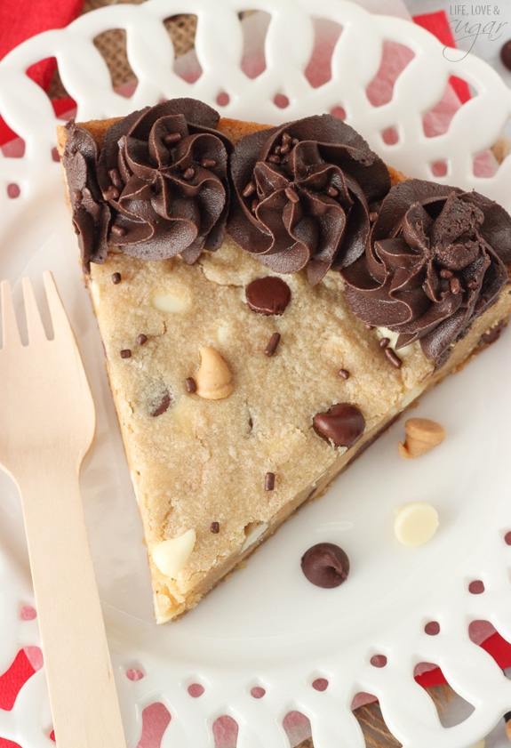 Overhead view of a slice of Triple Chocolate Chip Cookie Cake on a white plate