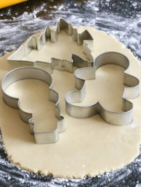 Cutout Sugar Cookies with Royal Icing dough with cookie cutters close up