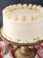 Eggnog Layer Cake on wooden stand close up