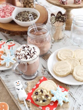 hot chocolate bar featuring white chocolate cranberry cookies and maple iced cookies