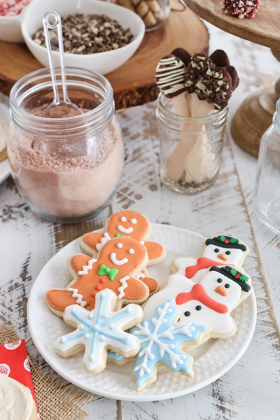 cutout sugar cookies on a plate - snowflakes, snowmen and gingerbread men