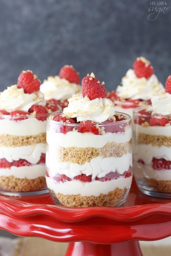 Raspberry Amaretto Cheesecake Trifles on a cake stand