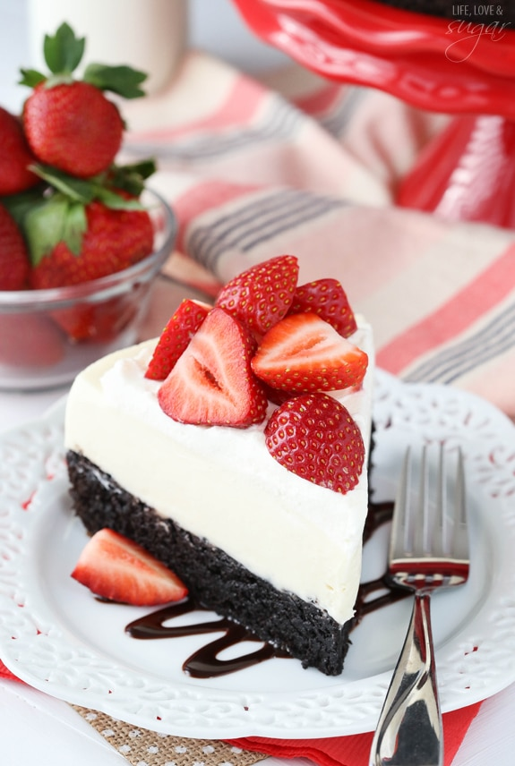 Strawberry Brownie Cheesecake - A moist and chewy brownie topped with no bake vanilla cheesecake, whipped cream and fresh strawberries! Delicious!