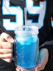 Carolina Panther Punch in front of Panthers jersey