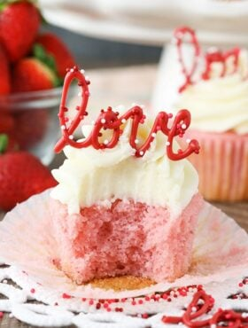 image of Strawberry Cupcake with Cream Cheese Frosting with bite taken out