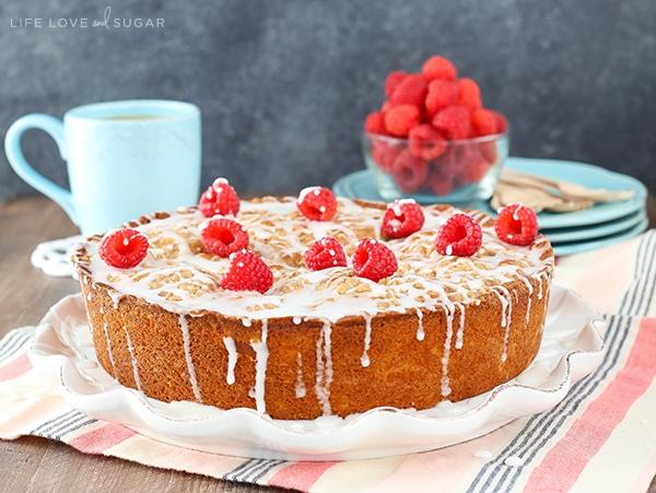 horizontal image of Raspberry Cream Cheese Coffee Cake on white platter