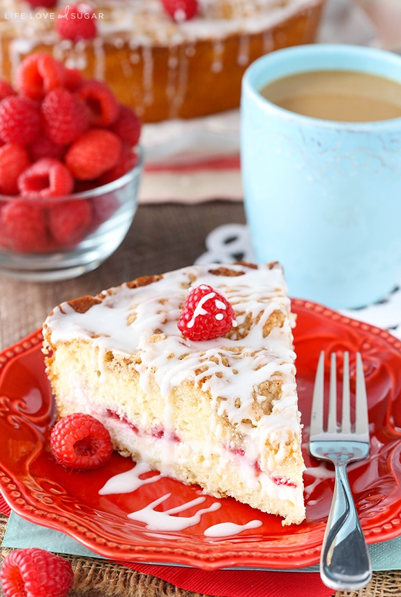 A slice of Raspberry Cream Cheese Coffee Cake on a red plate
