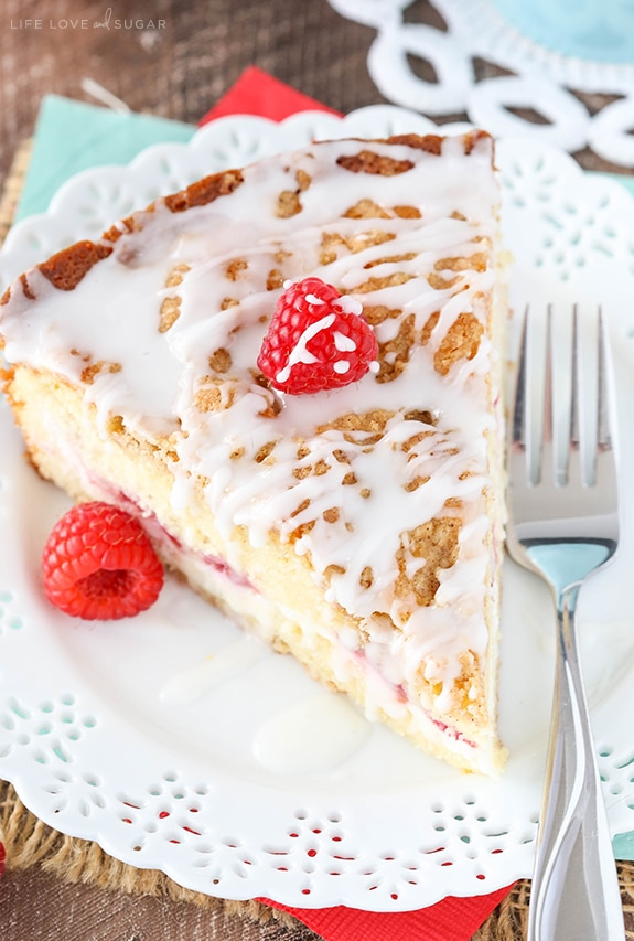 close up of Raspberry Cream Cheese Coffee Cake on white doily plate