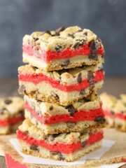 Red Velvet Cheesecake Chocolate Chip Cookie Bars - Chewy chocolate chip cookie surrounds red velvet cheesecake! Easy to make and great for Valentine's Day!