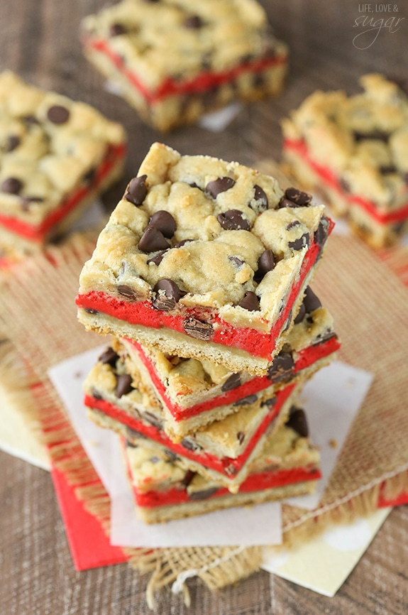 Red Velvet Cheesecake Chocolate Chip Cookie Bars - Chewy chocolate chip cookie surrounds red velvet cheesecake! Easy to make and great for Valentines Day!