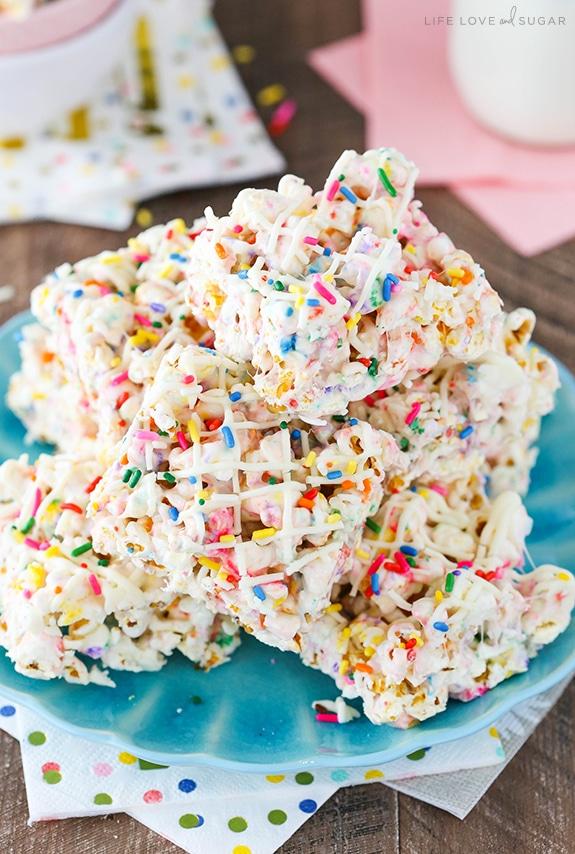 Funfetti Marshmallow Popcorn Treats on blue plate