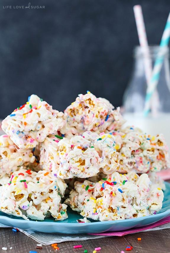 Funfetti Marshmallow Popcorn Treats stacked on plate