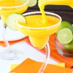 image of Mango Margaritas being poured into a glass
