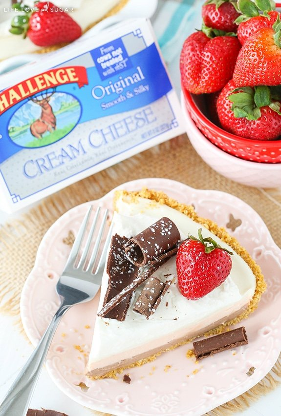 No Bake Neapolitan Cheesecake Pie slice with chocolate curls