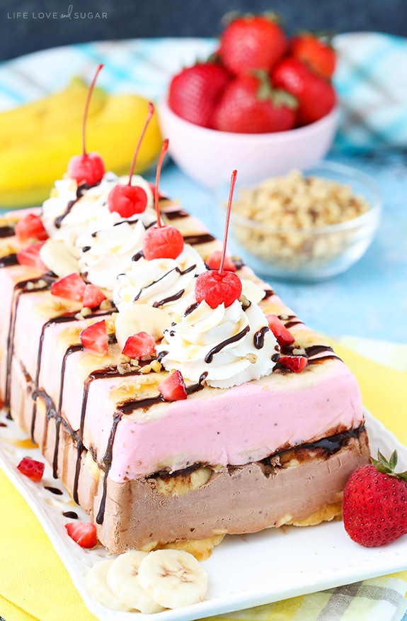 Banana Split Ice Cream Cake Loaf - layers of chocolate and strawberry ice cream, shortbread, bananas, nuts and pineapple! So fun and perfect for summer! It's also gluten free!