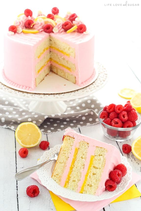 Lemon Raspberry Layer Cake - a light, moist lemon cake with lemon curd filling and raspberry frosting! So light, sweet, tart and the perfect dessert for summer!