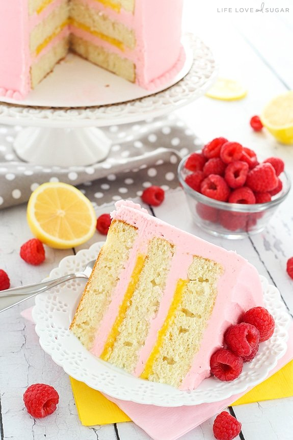 Lemon Raspberry Layer Cake - a light, moist lemon cake with lemon curd filling and raspberry frosting! So light, sweet, tart and the perfect dessert for summer!