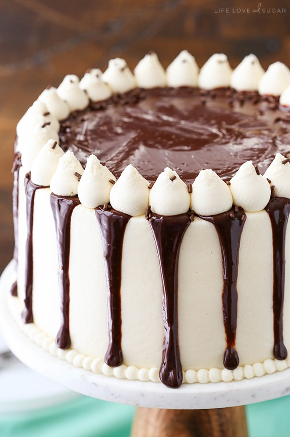 A baileys cake with white frosting and chocolate ganache