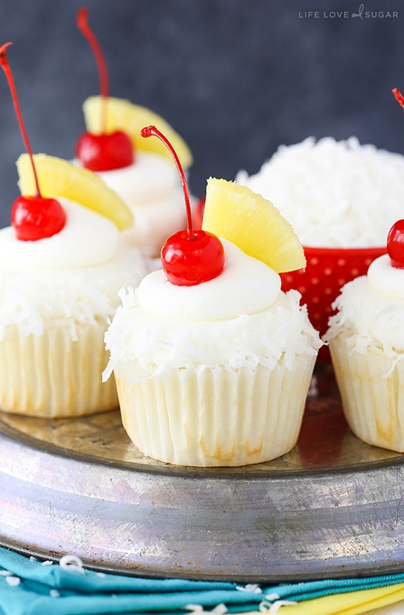 Pina Colada Cupcakes - moist, fluffy pineapple cupcakes with coconut frosting! So tasty and perfect for summer!