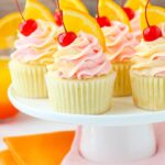 image of Tequila Sunrise Cupcakes on cake stand