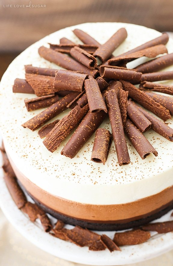 Triple Chocolate Mousse Cake - a layer of dense chocolate cake, chocolate fudge, chocolate mousse and white chocolate mousse! Delicious!