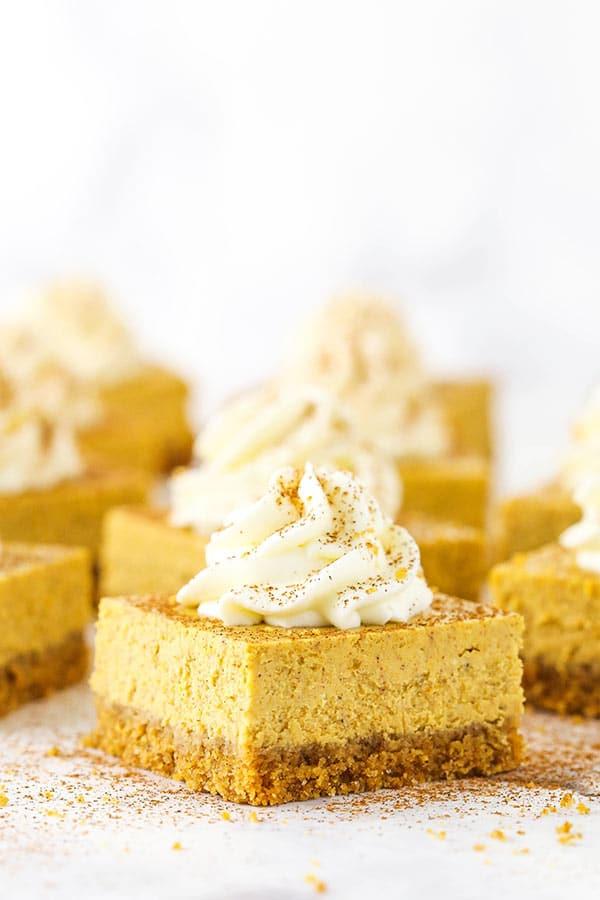 Pumpkin Cheesecake Bars on white surface